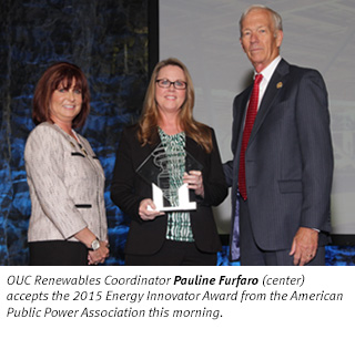 OUC Renewables Coordinator Pauline Furfaro (center) accepts the 2015 Energy Innovator Award from the American Public Power Association this morning.