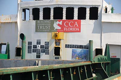 OUC sign on boat.