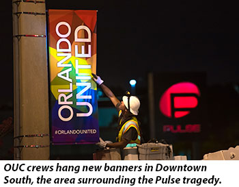 OUC crews hang new banners in Downtown  South, the area surrounding the Pulse tragedy.